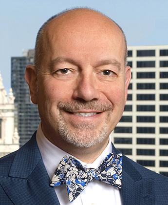 John M.  Riccione